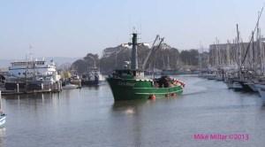 fishing boat returns to harbor